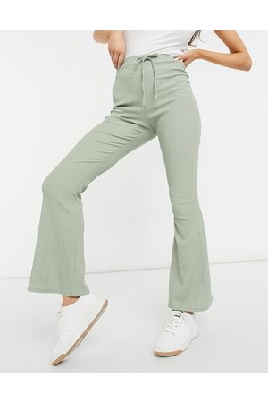 ASOS Textured flare trouser with tie waist in sage