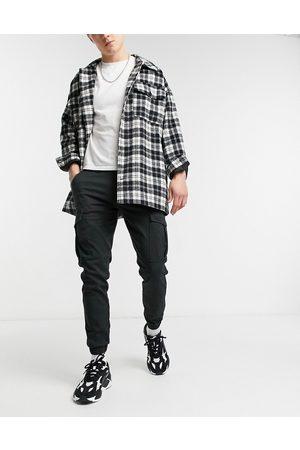 Jack & Jones Intelligence cargo trousers with cuff in black