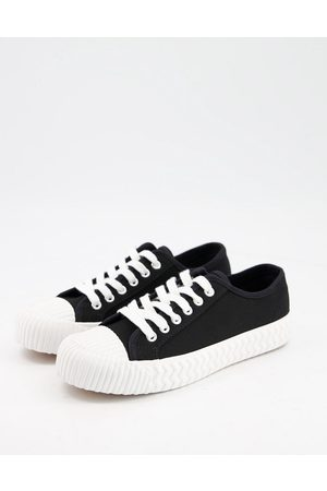Schuh Mia lace up flatform canvas trainers in black