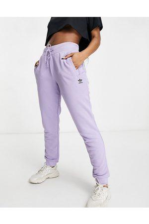 adidas Trefoil Essentials logo cuffed joggers in purple