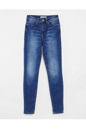adidas Jona high rise skinny jeans in medium blue wash