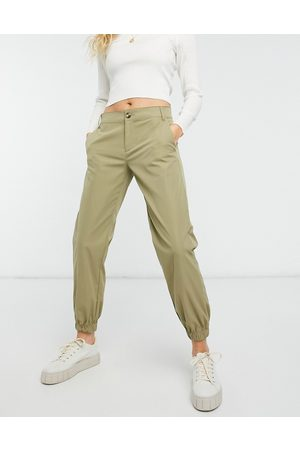 adidas Mujer Leggings y treggings - Button front straight leg trouser in green