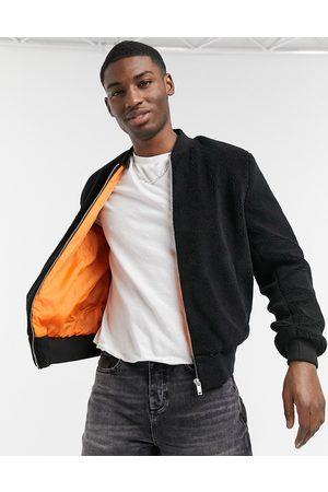 adidas Borg bomber jacket in black