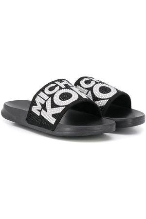 Michael Kors Slippers con detalles y logo