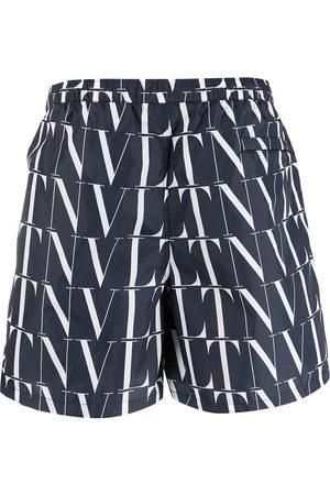 VALENTINO Hombre Shorts - Shorts de playa con estampado VLTN