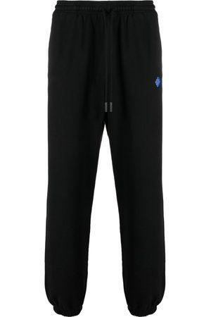 MARCELO BURLON Pants con motivo geométrico