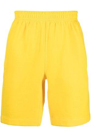 Styland Shorts deportivos con parche del logo