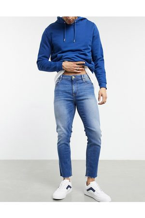 ASOS Cropped skinny jeans in vintage dark wash with raw hem