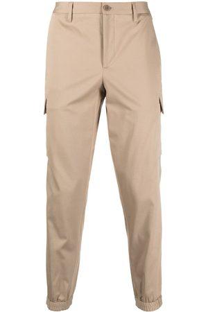Neil Barrett Pantalones de vestir con bolsillos