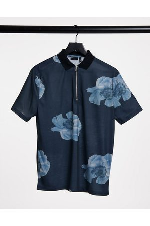 ASOS Relaxed half zip polo in all over dark floral print