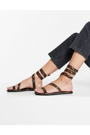 ASOS Forcefield flat sandals in brown snake