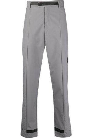 A-cold-wall* Pantalones rectos con placa del logo