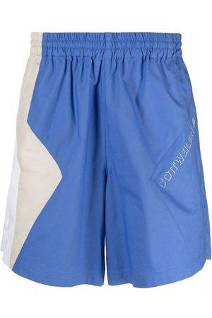 Reebok Shorts deportivos con diseño colour block
