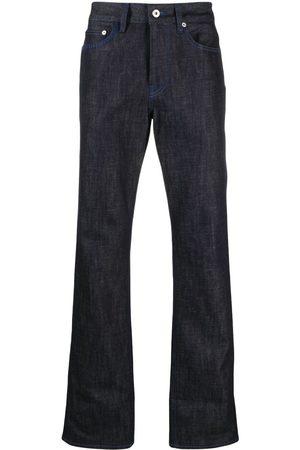 MARCELO BURLON Jeans rectos con logo estampado