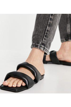 Simmi Wide Fit Simmi London Wide Fit Latana flat sandals with padded twist upper in black