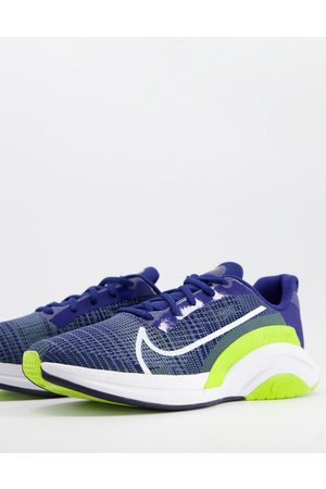 Nike SuperRep Surge trainers in blue