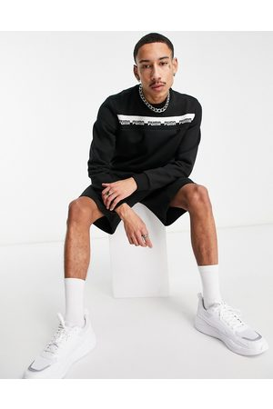 PUMA Amplified chest logo sweatshirt in black