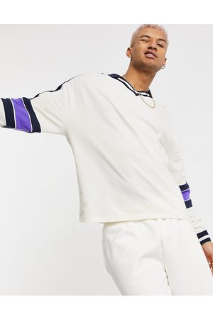 ASOS Oversized long sleeve polo shirt in off white pique with stripe