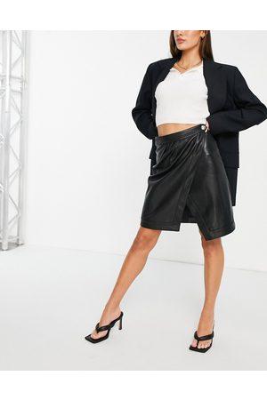 Morgan Mujer Faldas - Pu wrap skirt in black
