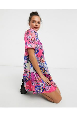 Liquorish Smock mini dress with puffy sleeves in pink floral print