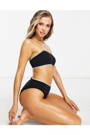 ASOS Seamless bra top with logo strapping in black
