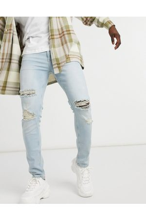 ASOS Hombre Skinny - Skinny jeans in vintage light wash with rips