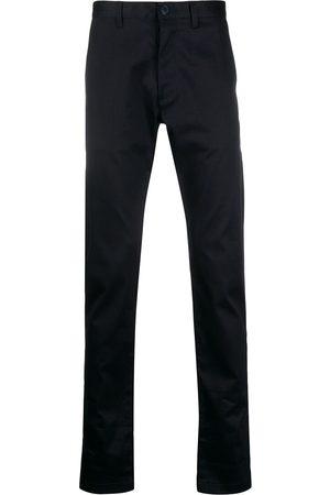 Saint Laurent Pantalones tipo chino slim