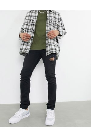 ASOS Skinny jeans in washed black with thigh abrasions