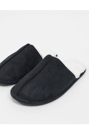 ASOS Slip on slippers in black with cream faux fur lining