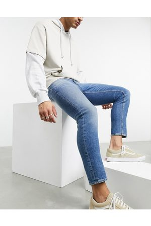 ASOS Cropped skinny jeans in vintage mid wash with abrasions