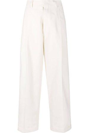 Maison Margiela Pantalones de talle alto con aberturas