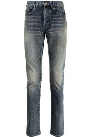 Saint Laurent Skinny jeans con efecto desgastado
