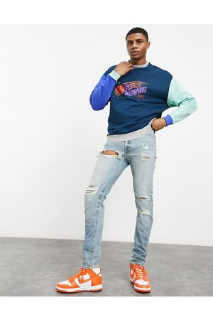 ASOS Skinny jeans in light wash with heavy rips