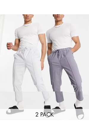 ASOS DESIGN 2 pack slim chinos with elastic waist and pin tuck in stone and grey save