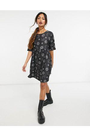 Urban Threads Celestial print babydoll smock dress in black