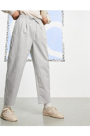 ASOS Wide fit ankle grazer trousers in salt and pepper fleck