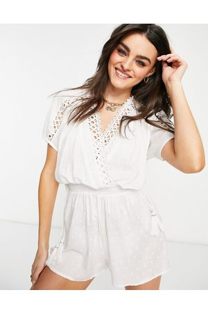 River Island Textured plunge beach playsuit in white