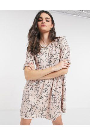 Urban Threads Face print babydoll smock dress in pink