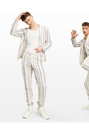 ASOS Hombre Slim y skinny - Soft tailored linen slim suit trousers multi stripe in white and blue