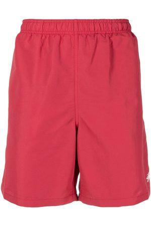 Stussy Shorts de playa con logo estampado