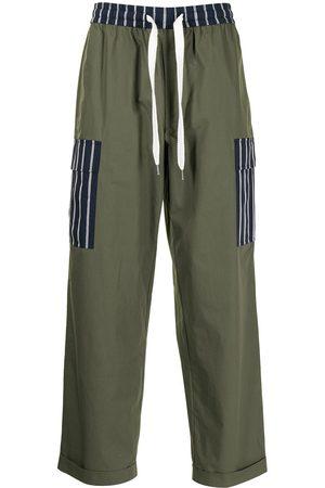 Ports V Pantalones con paneles a rayas