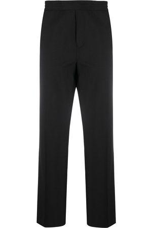 Acne Studios Pantalones rectos con pretina elástica