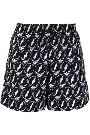 AMIRI Shorts de playa con estampado de calaveras