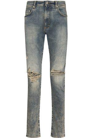 Represent Skinny jeans con detalles rasgados