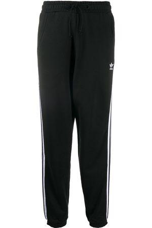 adidas Pants con rayas laterales