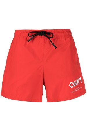 MARCELO BURLON Shorts de playa con logo estampado