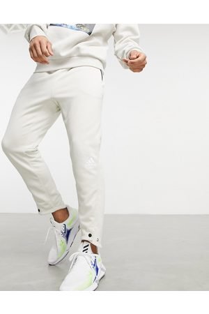 adidas performance Hombre Joggers - Adidas Yoga tech joggers in stone