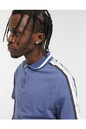 ASOS DESIGN Skinny polo shirt in blue with sleeve taping