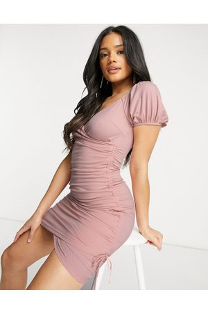 Parallel Lines Ruched cross over mini dress in mink