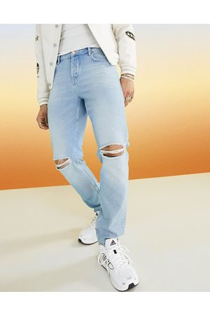 ASOS Slim jeans in vintage light wash with knee rips
